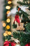 Christmas toy train and garland on the fir tree Royalty Free Stock Image
