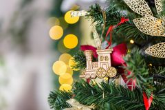 Christmas toy train and garland on the fir tree. Vertical photo Stock Photo