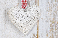 Christmas Toy wood heart  on wooden background. Christmas decoration heart-shaped.Toy - white wood heart  on wooden background Stock Photography