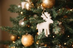 Christmas toy wooden deer on the Christmas tree stock photos