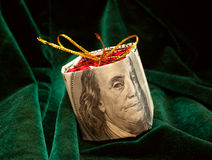 The Christmas toy wrapped in the dollar bill Royalty Free Stock Photos