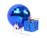 Christmas Toys. Blue glass bowl and a gift. Soft shadow royalty free stock photography