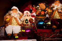 Christmas toys. Small toys for sale representing Santa Claus, a snowman and a reindeer Stock Photo
