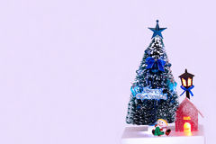 Christmas toys. Christmas tre with lit lamp and house Royalty Free Stock Photos
