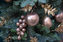 Christmas toys. Golden fruits on christmas tree royalty free stock photos