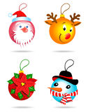 Christmas toys. Four Christmas balls: Santa, reindeer, flower and snowman Royalty Free Stock Photo