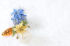 Christmas toys. On snow background stock photo
