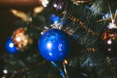 Christmas toys balls close-up on a festive tree backgrounds Royalty Free Stock Image