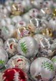 Christmas toys balls silver with the image of a pig and a Christmas tree royalty free stock photography