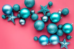 Christmas toys. Blue balls and stars on pink background top view copyspace Royalty Free Stock Photography