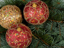Christmas toys on branches of a fur-tree Royalty Free Stock Image