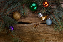 Christmas toys and branches of tree lit candle stock photo