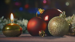 Christmas toys and burning candle stock footage