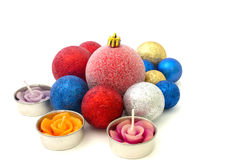 Christmas toys and candles on a white Royalty Free Stock Photography