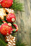 Christmas toys, candy and gingerbread cookies. Stock Image