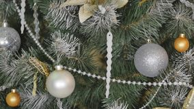 Christmas toys on a Christmas tree under snow.  stock video footage