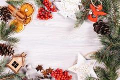 Christmas toys, cinnamon and oranges Royalty Free Stock Photos