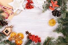 Christmas toys, cinnamon and oranges Stock Photos