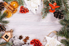 Christmas toys, cinnamon and oranges Stock Images