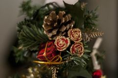 Christmas toys and decorations. New Years toys. Golden rose and cone. royalty free stock photos