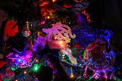 Christmas toys and decorations on the Christmas tree. royalty free stock images