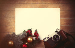 Christmas toys with fir-tree branch and camera Stock Photo