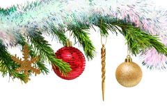 Christmas toys on fir tree twig over white Stock Images