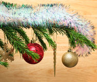 Christmas toys on fir tree twig and wood background Royalty Free Stock Photo