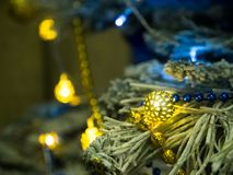 Christmas toys and garlands on the branches of the Christmas tree stock photos
