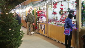 Christmas toys and gifts. BARCELONA, SPAIN - NOVEMBER 30, 2015: Traditional Christmas toys and gifts at stand in evening. Barcelona, Catalonia. Christmas market