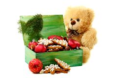 Christmas toys and gingerbread in a box. Royalty Free Stock Image
