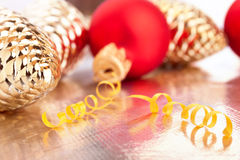 Christmas toys on the golden background Stock Photography