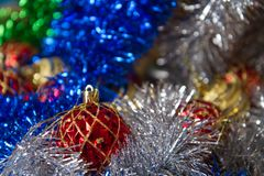 Christmas toys golden and red color in tinsel, blue, silver and green colors Stock Photos