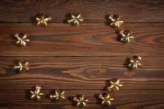Christmas toys golden stars  on  wooden background concept Chris Stock Image