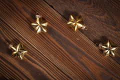 Christmas toys golden stars  on  wooden background concept Chris Stock Photography