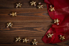 Christmas toys golden stars  on  wooden background concept Chris Royalty Free Stock Photography