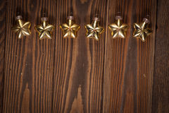 Christmas toys golden stars  on  wooden background concept Chris Stock Photos
