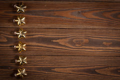 Christmas toys golden stars  on  wooden background concept Chris Royalty Free Stock Photo