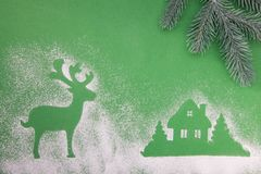 Christmas toys, handmade wooden moon star and deer, on a green background. stock image