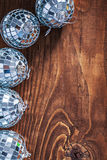 Christmas toys mirror disco balls on old wooden board with copys Royalty Free Stock Image
