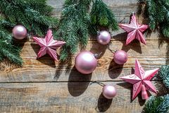 Christmas toys near pine branches on wooden background top view copyspace Royalty Free Stock Photography