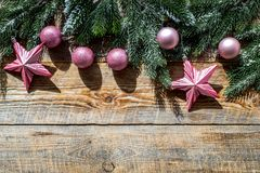 Christmas toys near pine branches on wooden background top view copyspace Stock Images