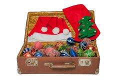 Christmas toys in old vintage suitcase isolated on white background stock image