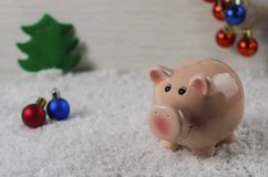 Christmas toys pig symbol of the new year on the background of snow 2 royalty free stock photography