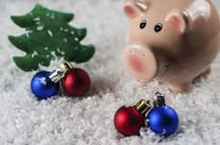 Christmas toys pig symbol of the new year on the background of snow stock images
