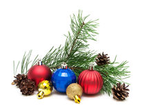Christmas toys, pine cones and pine branches on a white backgrou Royalty Free Stock Photos