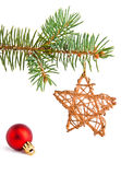 Christmas toys and pine-tree. Christmas tree decoration on the pine tree Royalty Free Stock Photos