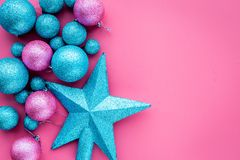 Christmas toys pattern. Pink and blue balls and stars on pink background top view copyspace Stock Photography