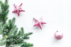 Christmas toys. Pink stars near pine branches on white background top view copyspace Royalty Free Stock Photos