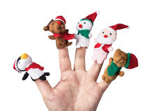 Christmas toys put on a hand on a white Stock Images